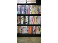 Collection of 64 comedy VHS tapes.