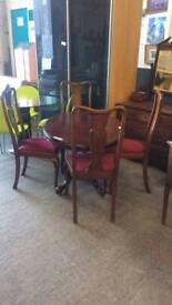 Vintage Oval Dining Table. 4 Maroon Cushioned Chairs
