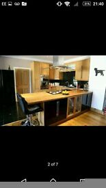 Oak and black gloss kitchen with Smeg appliances