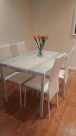 White glass table and chairs