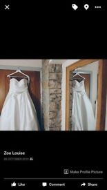 Beautiful wedding dresssize 14 cleaned emmaculate
