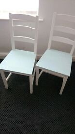 two halk-painted chairs