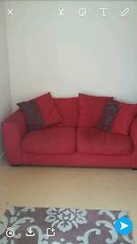 Red 2 seater sofa. Very comfy.