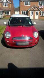 Mini Cooper in red with white roof and alloys