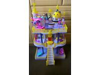 My little pony castle with various accessories including helicopter
