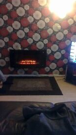 electric fire with glass front good condition has remote but remote is melted but still works