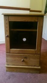 Pine cabinet with glass door and shelves and draw