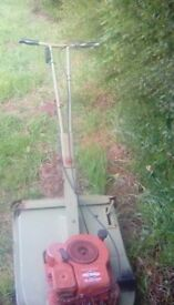 Bridge and Stratton 3.5 HP petrol lawnmower with grass collection