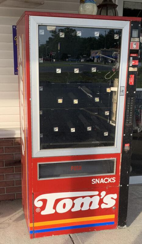Vintage Tom's Snack vending machine.