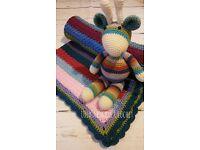 handmade crochet blanket and giraffe toy