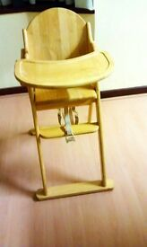The wooden high chair.