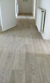 Fully fitted 8mm grey laminate flooring with underlay beading door bar 20m2 5x4
