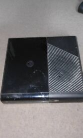xbox 360 in black with controller