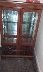 Fine mahogany glass cabinet with back light. Porthcawl.