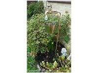 Solar tap light with bucket planter