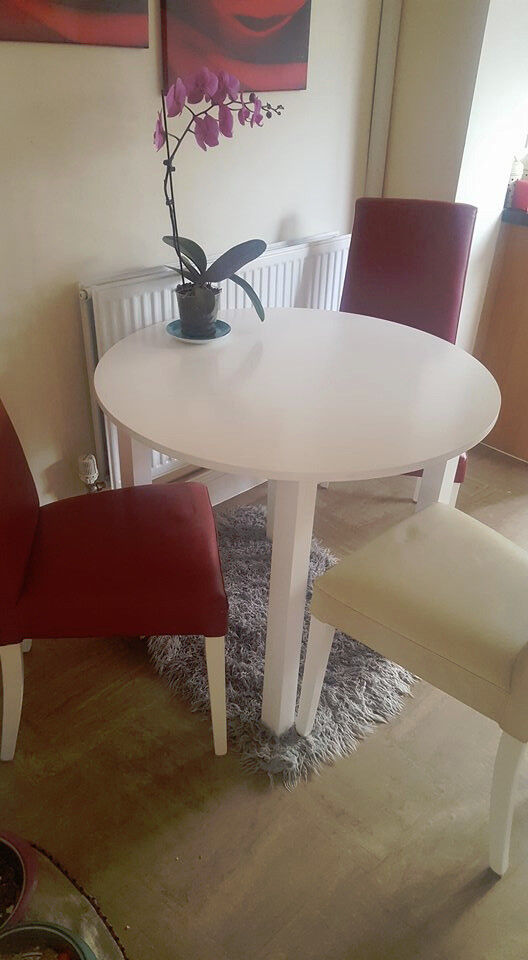 White wood table with 3 chairs