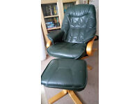Pair of Green leather swivel reclining chairs