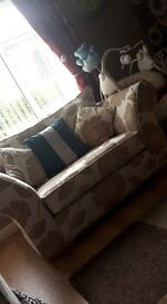 3 peice cream with biscuit coloured flowers sofas 4 seater sofa, 2 sester sofa and a cuddle chair