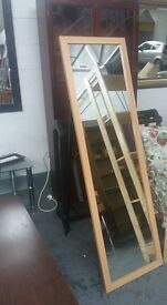 Full length bedroom mirror. complete with metal stand Delivery can be arranged if required.