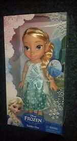 Toddler Elsa with glittering snowflake gown