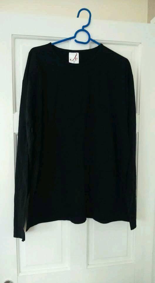 8 X large black long sleeve tops never worn