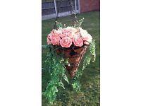 Handmade flowers in hanging basket