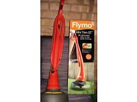 Grass trimmer Flymo. Used only three times. Very good condition.