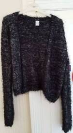 Woman's long sleeved fluffy cardigan