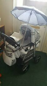 White and grey leopard print pram