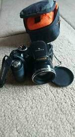 Fujifilm 14mp camera with lens, flash, and accessories