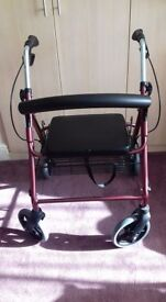 Four Wheeled Walker With Seat and Basket