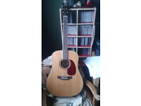 Spd 25 dreadnought acoustic guitar with built in tuner.
