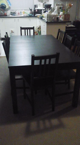 Black extendable timber table with 12 matching chairs Penrith Penrith Area Preview
