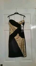 New with tags Black and Gold bodycon dress. Size 8