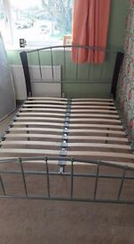 Double bed frame in metal and wood.