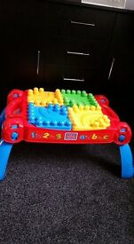 Fisher price mega blok table