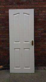 Interior door complete with 'brass' handles and hinges.