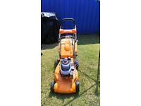 partner petrol lawn mowers
