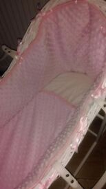 White pink wicker moses basket