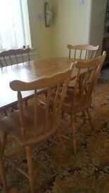 Table with 4 chairs and 2 carver chairs - good condition.