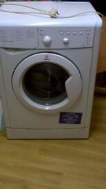 Washing machine for sale £50 pick up only fully working just bought a new black one