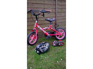 Boys bike for sale, includes the stabilisers which were removed and helmet.