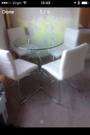 Glass table and 4 padded cream chairs