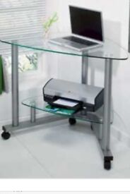 Glass and silver corners desk on wheels