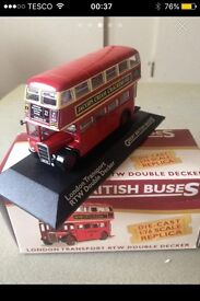 Double decker red London bus model and original box
