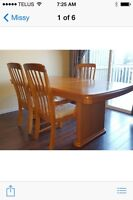 Solid wooden table with 6 chairs.