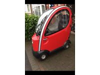 mobility scooter for sale excellent condition red in colour would window wipers and it is in closed