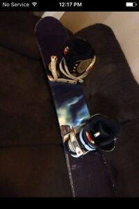 Storm snowboard and size 8 boots $50