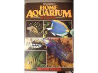gravel fish bowl and 3 tropical fish books