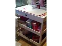 White baby changing unit with mat